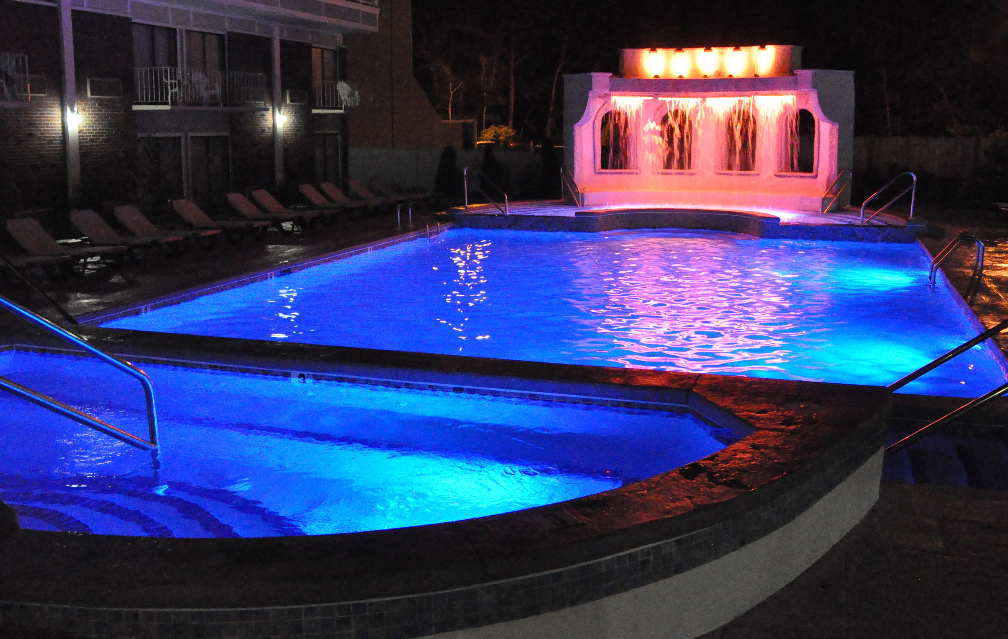 Rainbow Falls Heated Outdoor Pool at Night